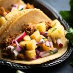 Gluten free taco, with pulled pork and fruit salsa