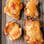 Crispy skillet chicken thighs on a wire rack