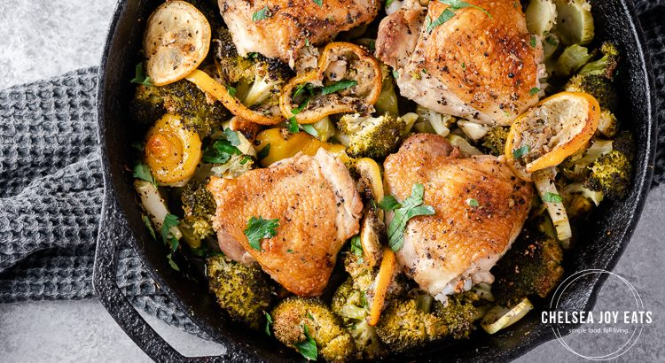 Cast iron skillet with roasted chicken thighs and broccoli