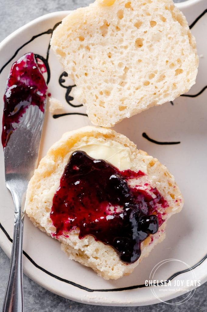 Closeup of gluten free dinner rolls with butter and jam