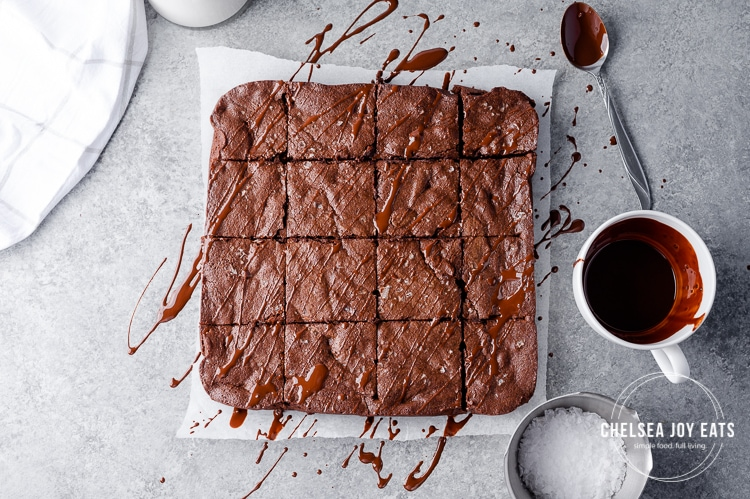 Bird's eye view of cut brownies drizzled in melted chocolate