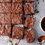 Cut gluten free brownies drizzled with melted chocolate