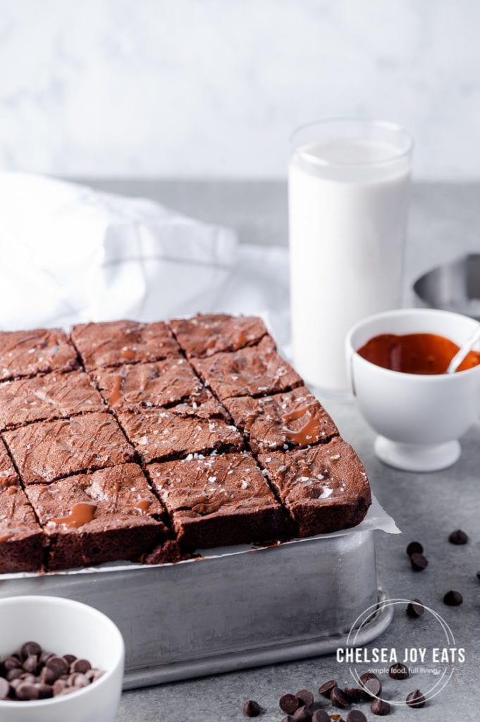 Cut brownies on an upside-down tray garnished with chocolate chips and sea salt flakes