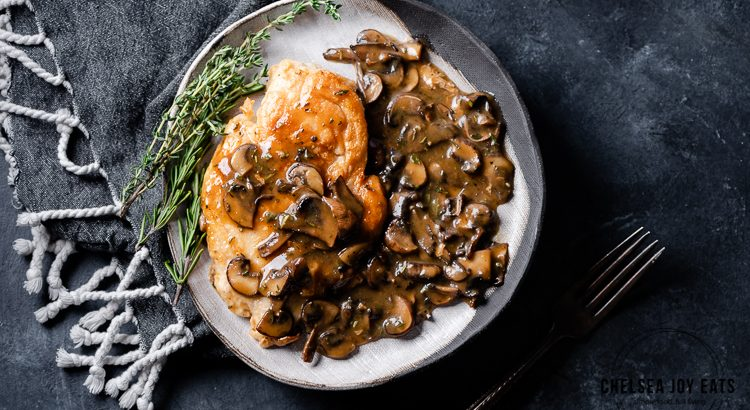 One skillet chicken cutlets with mushroom pan sauce on a dinner plate