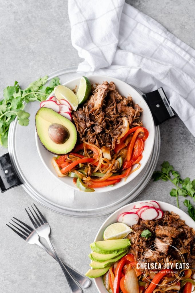 Pulled pork burrito bowls with rice, grilled peppers, and avocado