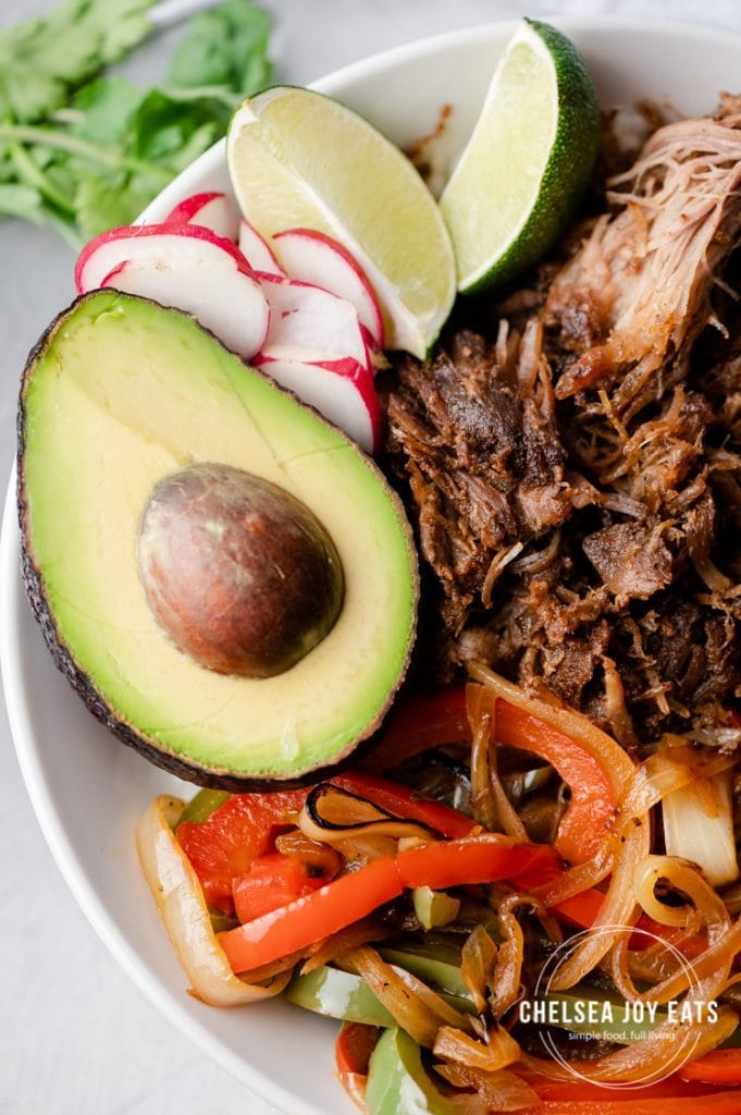 Closeup of avocado in pulled pork burrito bowl