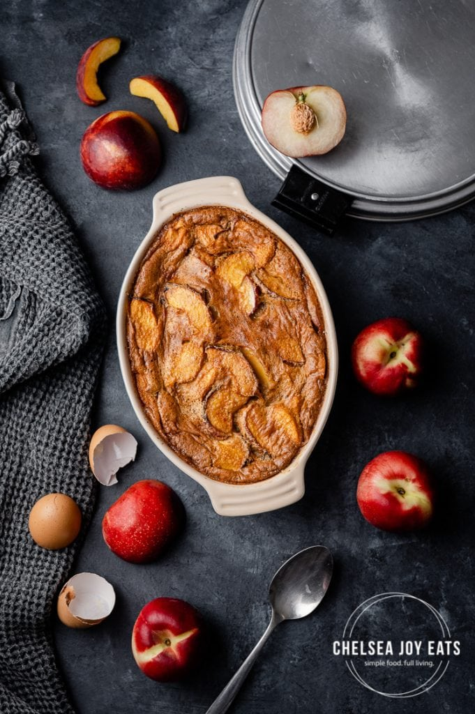 Low carb, gluten free peach clafoutis in a baking dish