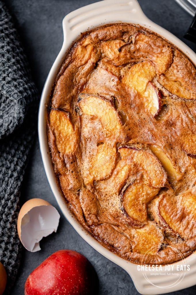 Closeup of summer peach clafoutis in a baking dish