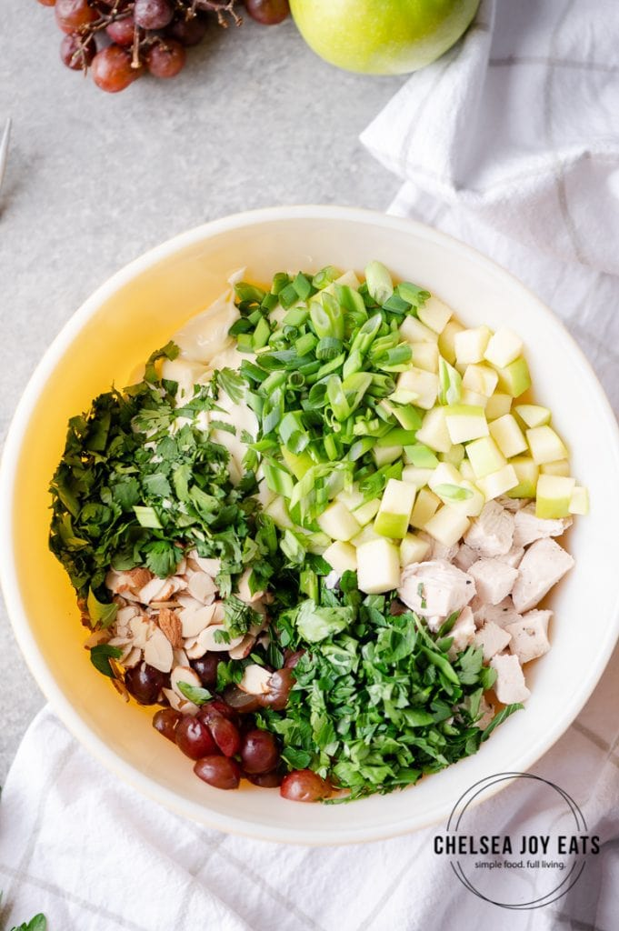 Bowl with ingredients for homemade chicken salad