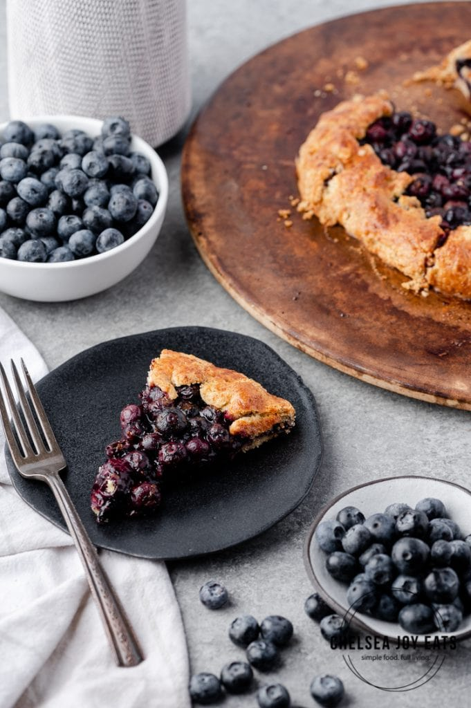 Slice of gluten free blueberry galette on a serving plate