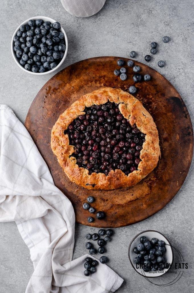 Gluten Free blueberry galette on a baking stone
